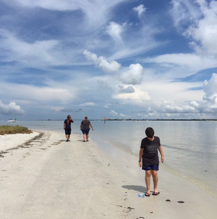 family walking on florida beach by monica calderin, @my_reverie, for childhood unplugged instagram