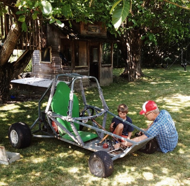 father and son working on a go cart together, image by sharakee prang for childhood unplugged instagram
